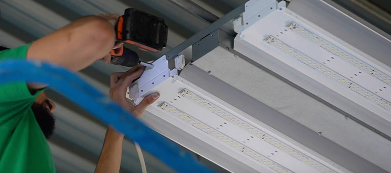 Retrofitting fluorescent high bay fixtures to LED
